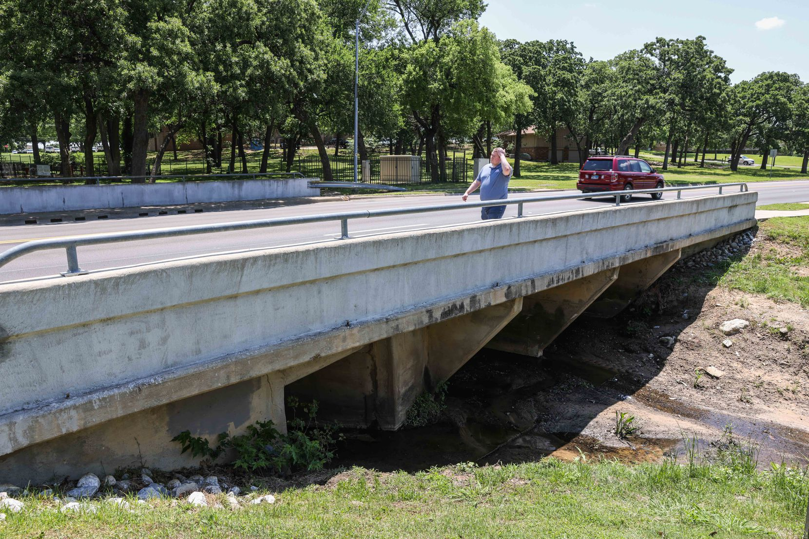 A drainage culvert under a small bridge around the 2100 block near The Arbors Apartments on Forest Ridge in Bedford on Friday, May 14, 2021. Nicholas Lloyd Nelson, a 37-year-old Tarrant County man suspect, admitted to setting off a homemade bomb last month at this location. (Lola Gomez/The Dallas Morning News)