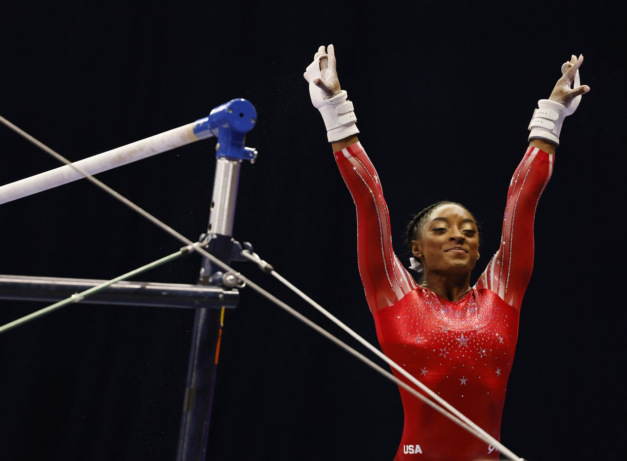 Simone Biles prepares to compete on the uneven bars during day 2 of the women's 2021 U.S. Olympic Trials at The Dome at America's Center on Saturday, June 27, 2021 in St Louis, Missouri.(Vernon Bryant/The Dallas Morning News)