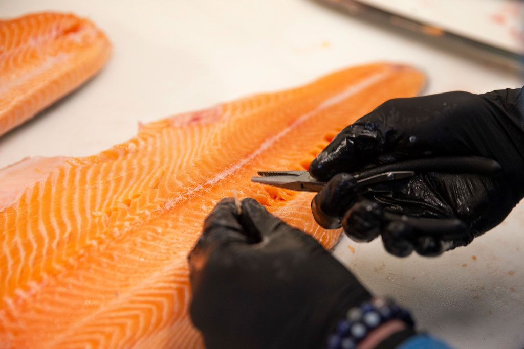 Rex's Seafood owner Beau Bellomy prepares a fish at Rex's Seafood in Dallas.