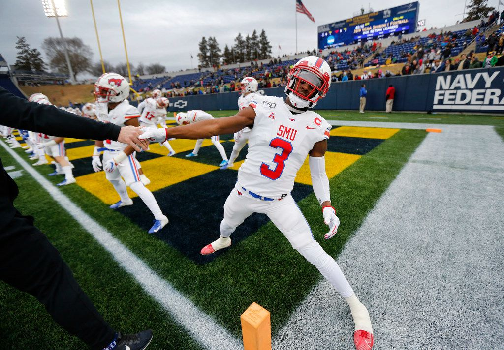 Southern Methodist Mustangs wide receiver James Proche (3) stretches with teammates during pregame warmups before facing Navy at Navy-Marine Corps Memorial Stadium in Annapolis, Maryland, Saturday, November 23, 2019. (Tom Fox/The Dallas Morning News)