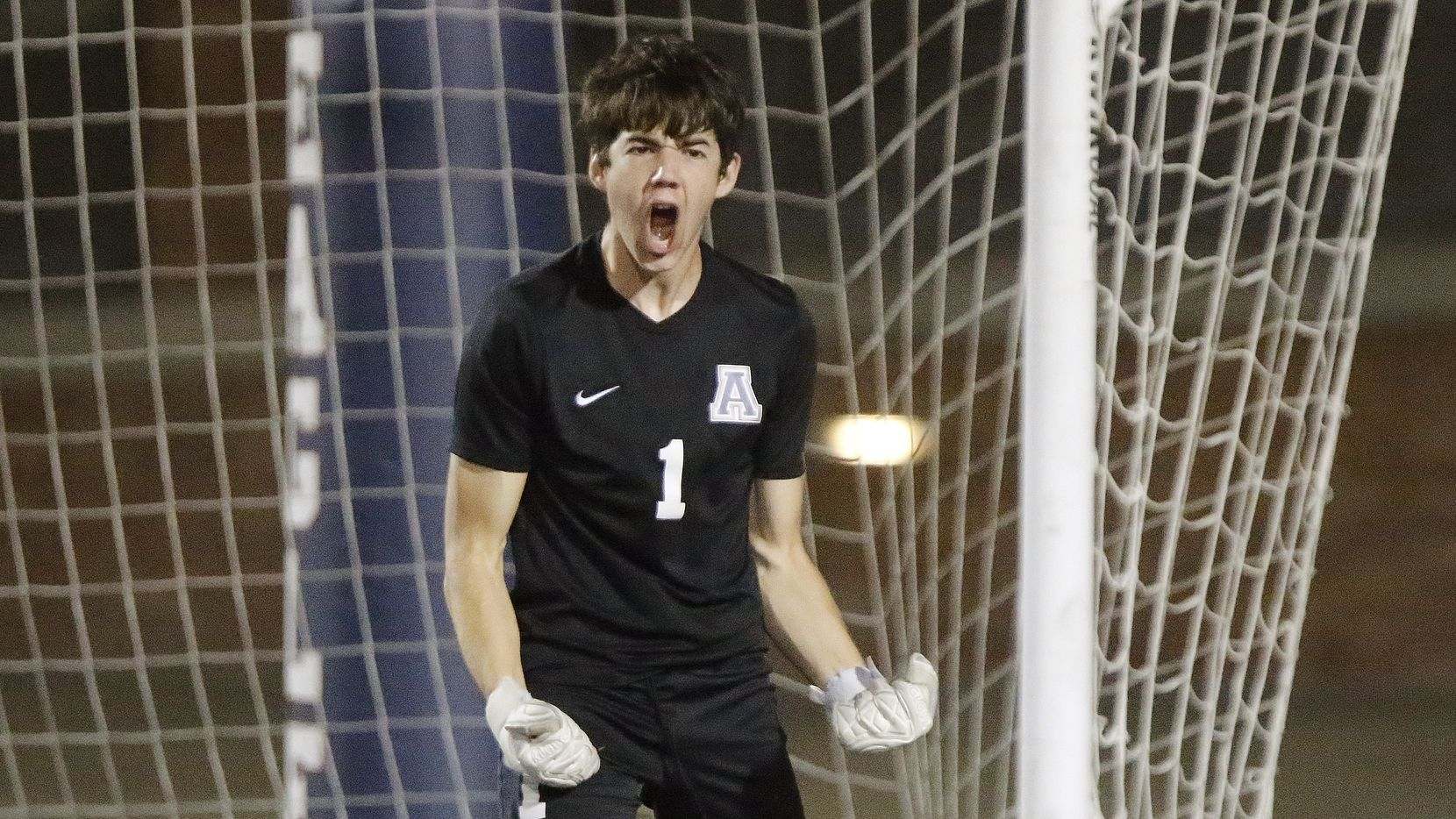Allen goalkeeper Jackson Leavitt (1) celebrates a stop during the shootout which followed three overtimes as Allen High School hosted Keller High School in the Class 6A Region I semifinal soccer match at Eagle Stadium in Allen on Tuesday, April 6, 2021.