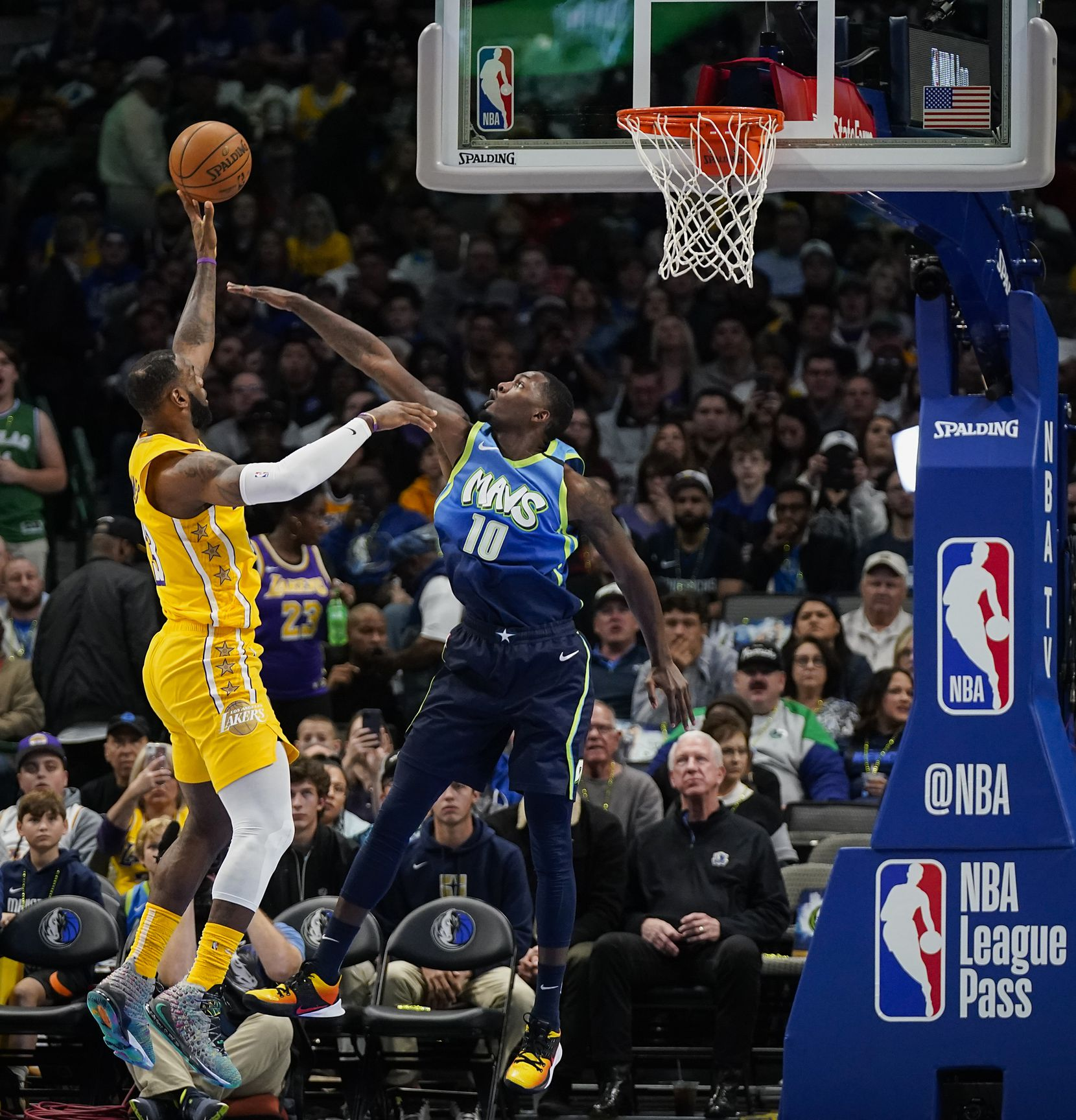 Los Angeles Lakers forward LeBron James (23) scores past Dallas Mavericks forward Dorian Finney-Smith (10) during the first half of an NBA basketball game at American Airlines Center on Friday, Jan. 10, 2020, in Dallas.
