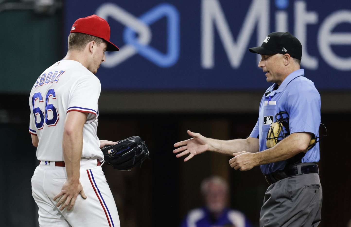 Home plate umpire Dan Iassogna inspects Texas Rangers relief pitcher Josh Sborz's glove during the sixth inning of a baseball game against the Oakland Athletics in Arlington, Monday, June 21, 2021. (Brandon Wade/Special Contributor)