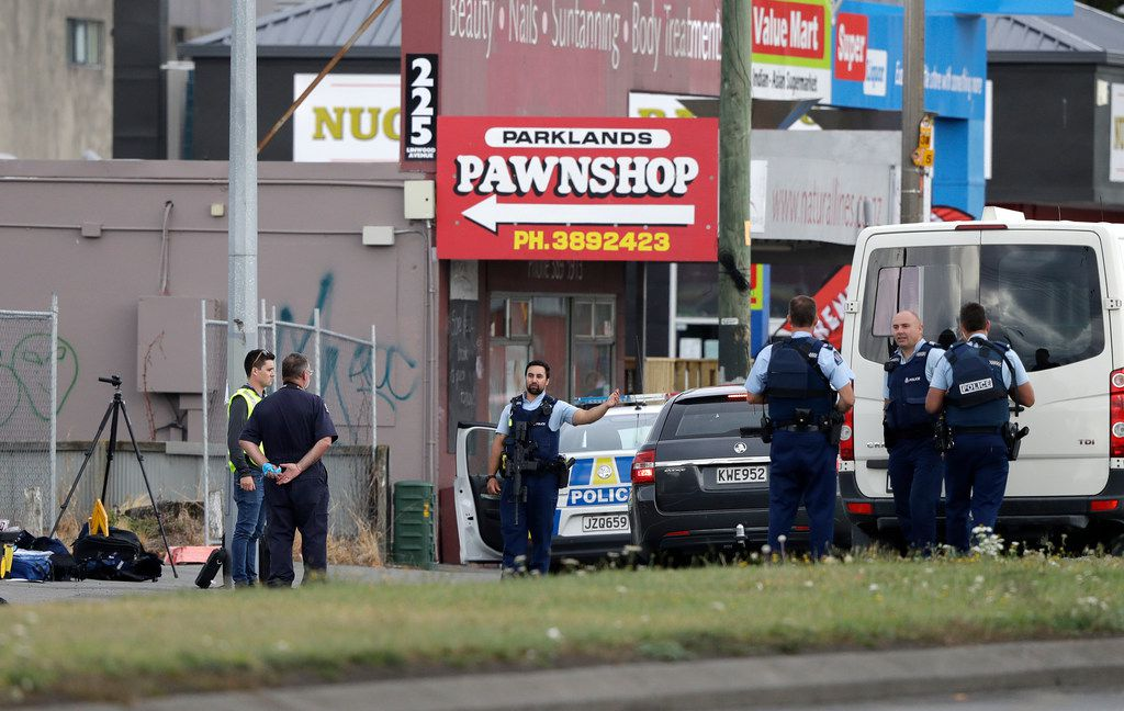 Police stand outside a mosque in Christchurch, New Zealand, Friday.