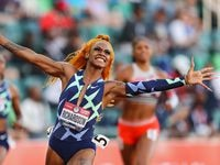 Sha'Carri Richardson celebrates winning the Women's 100 Meter final on day 2 of the 2020 U.S. Olympic Track & Field Team Trials at Hayward Field on June 19, 2021 in Eugene, Oregon.
