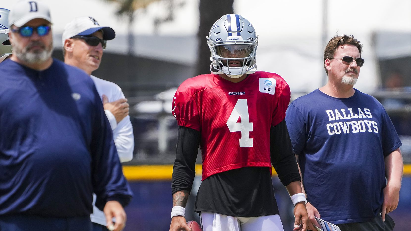 Dallas Cowboys quarterback Dak Prescott (4) watches with, from left head coach Mike McCarthy, quarterbacks coach Doug Nussmeier and consultant Bob McAdoo as he sits out of team drills during a practice at training camp on Wednesday, July 28, 2021, in Oxnard, Calif.
