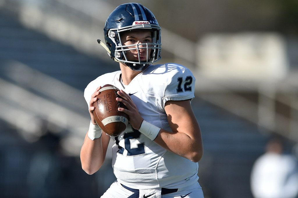 Argyle Liberty Christian quarterback Daniel Greek (12) drops back in the pocket, while the Bishop Lynch defense pressures him at Joy and Ralph Ellis Stadium.