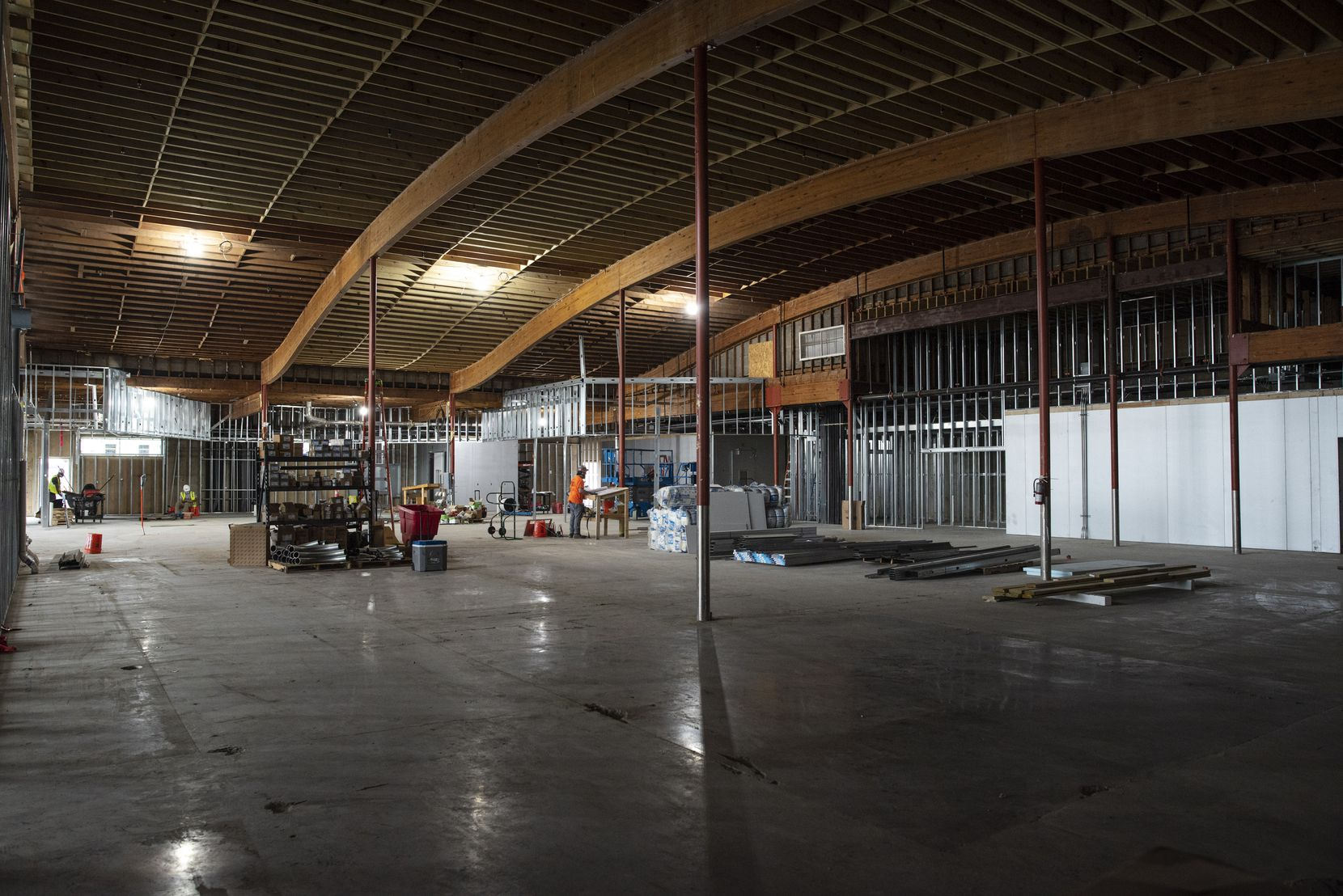 Construction is underway inside the Central Market at the Preston Oaks shopping center on Oct. 15. The grocery store, which was badly damaged during a tornado a year ago, is scheduled to open next year with upgrades including an expanded produce section and open floor plan.
