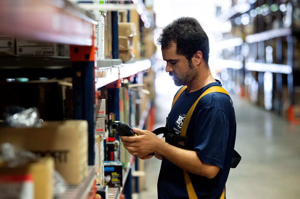 Pakistani refugee Abdul Fazal picks an order in the Elliott Electric Supply warehouse in Farmers Branch. In recent months, Elliott hired 10 refugees, but the number of refugees coming to the nation and the North Texas region has fallen sharply.