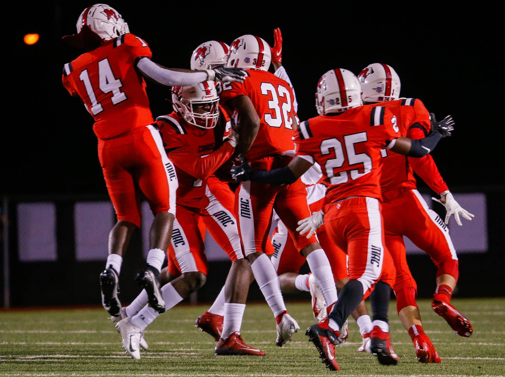 Irving MacArthur players celebrate Aaron Reagan's (32) interception during a the first half of a high school football game at Joy & Ralph Ellis Stadium in Irving on Friday, Oct. 23, 2020. (Juan Figueroa/ The Dallas Morning News)