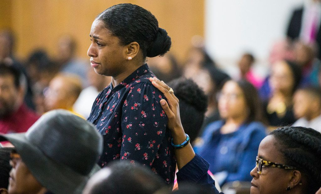 Cynthia Johnson, Botham Shem Jean's girlfriend,  is comforted by a fellow congregant during a prayer service Sunday at Dallas West Church of Christ.