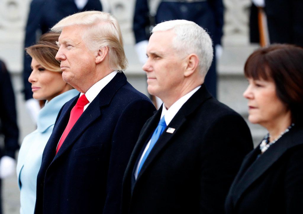 First Lady Melania Trump, United States President Donald Trump, Vice President Mike Pence and Karen Pence stand on the east front steps of the Capitol Building after Trump is sworn in at the 58th Presidential Inauguration on Capitol Hill in Washington, D.C. on January 20, 2017.