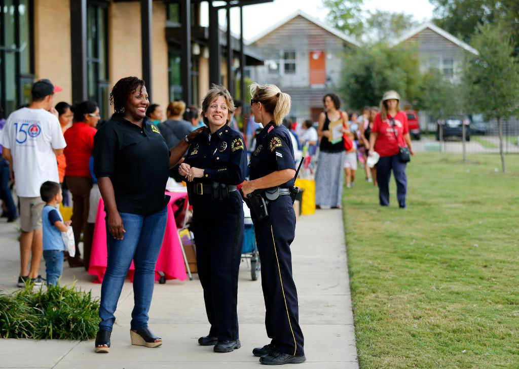 Dallas police (from left) Sgt. Christie Thomas, Assistant Chief Christina Smith and Senior Cpl. Misty Coody visit at a National Night Out Celebration at Jubilee Park and Community Center in Dallas. (2016 File Photo/Tom Fox)