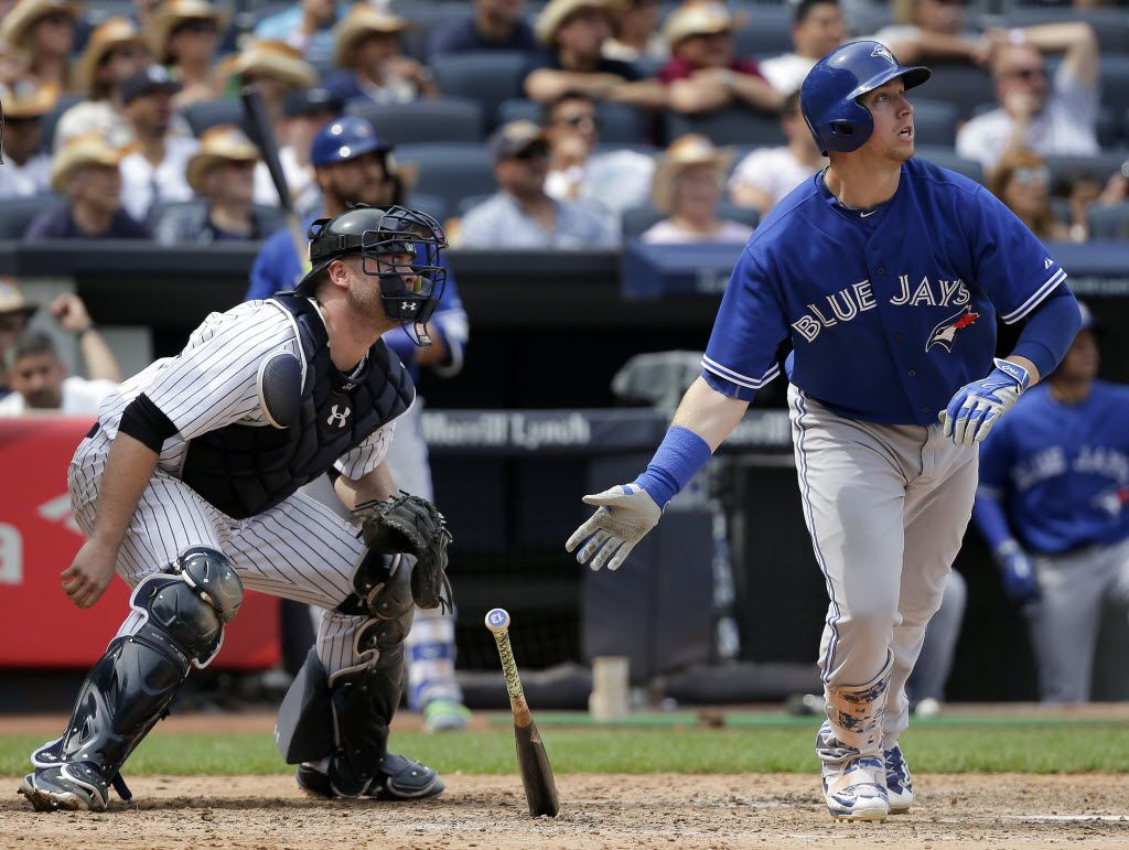 Toronto Blue Jays' Justin Smoak drops his bat after connecting for a grand slam home run as New York Yankees catcher Brian McCann watches during the sixth inning of a baseball game, Saturday, Aug. 8, 2015, in New York. (AP Photo/Julie Jacobson) 08092015xPUB
