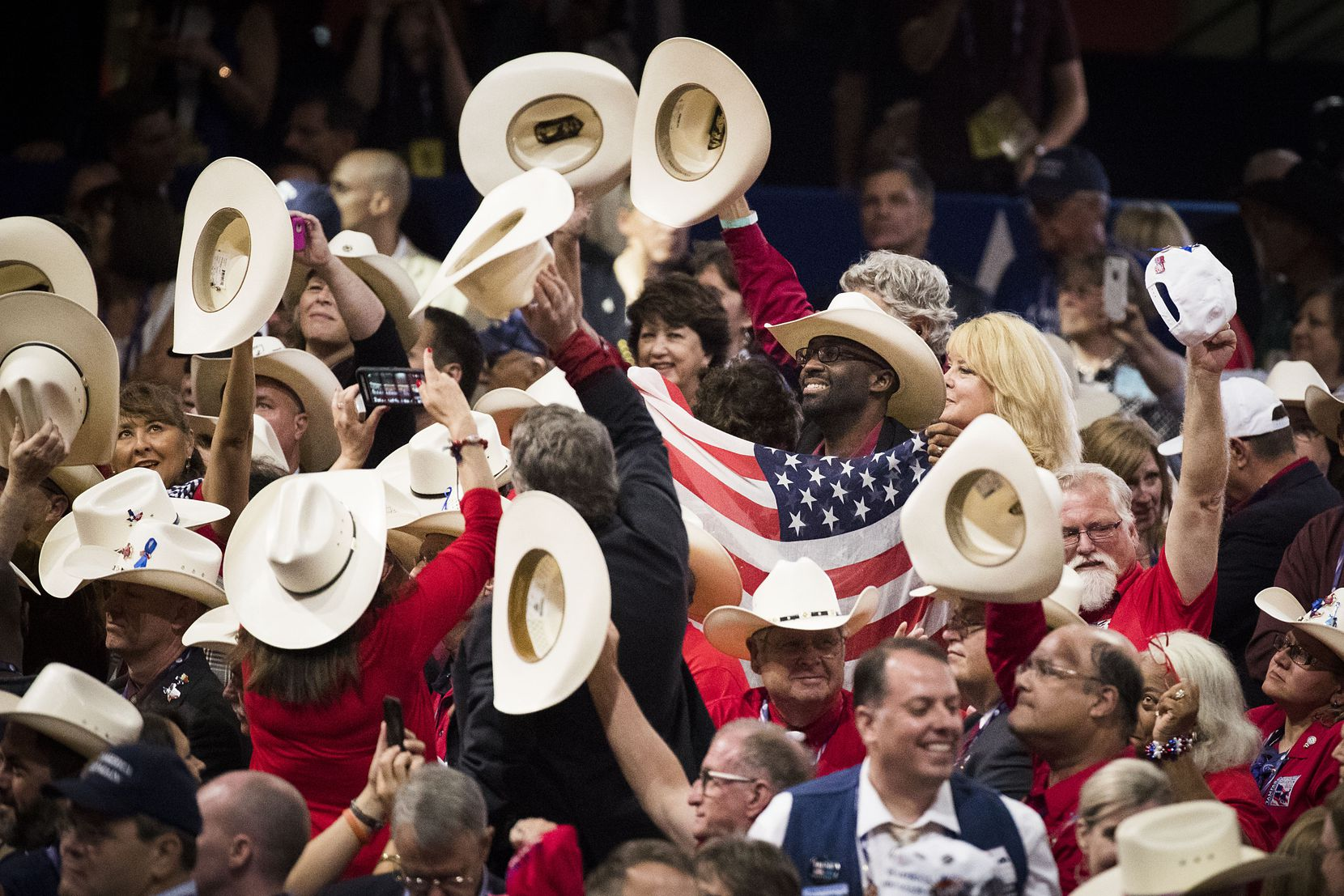 Texas delegates celebrate at the 2016 Republican National Convention in Cleveland. The 2020 convention will lack the energy of a packed arena.