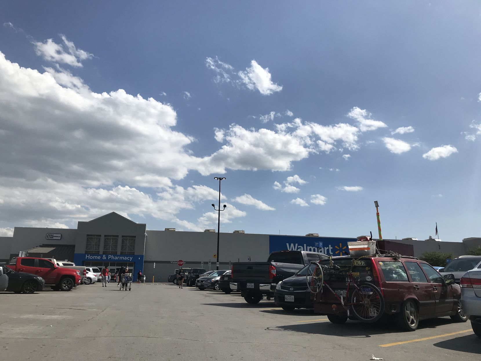 The Walmart parking lot at Cockrell Hill Road and I30 on the afternoon of Friday, April 24, 2020. Some shoppers wore masks to pick up everything from essentials like toilet paper to big-screen television sets.