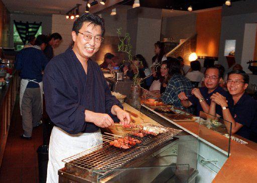 Teiichi Sakurai grilling yakitori at Teppo in 1995, the year it opened.