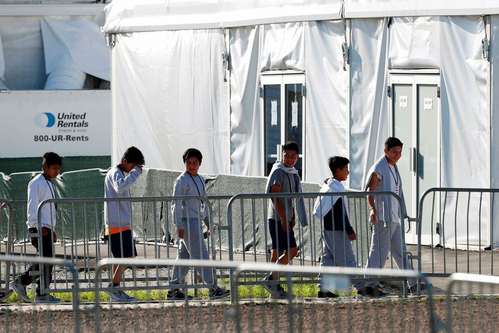 Children lined up to enter a tent at the Homestead Temporary Shelter for Unaccompanied Children in Homestead, Fla., earlier this year.