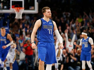 FILE - Mavericks guard Luka Doncic (77) smiles after making a 3-pointer late in overtime against the Pelicans at American Airlines Center in Dallas on Wednesday, March 4, 2020.