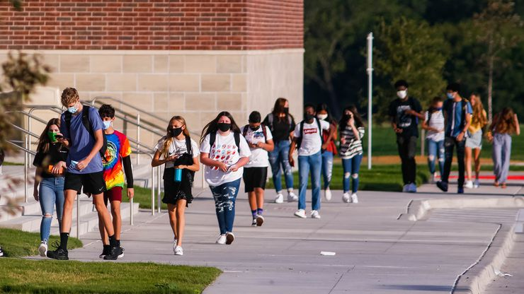 Students at Rock Hill High School walk into school for their first day back amid the pandemic on Aug. 12, 2020 in Frisco. (Juan Figueroa/ The Dallas Morning News)