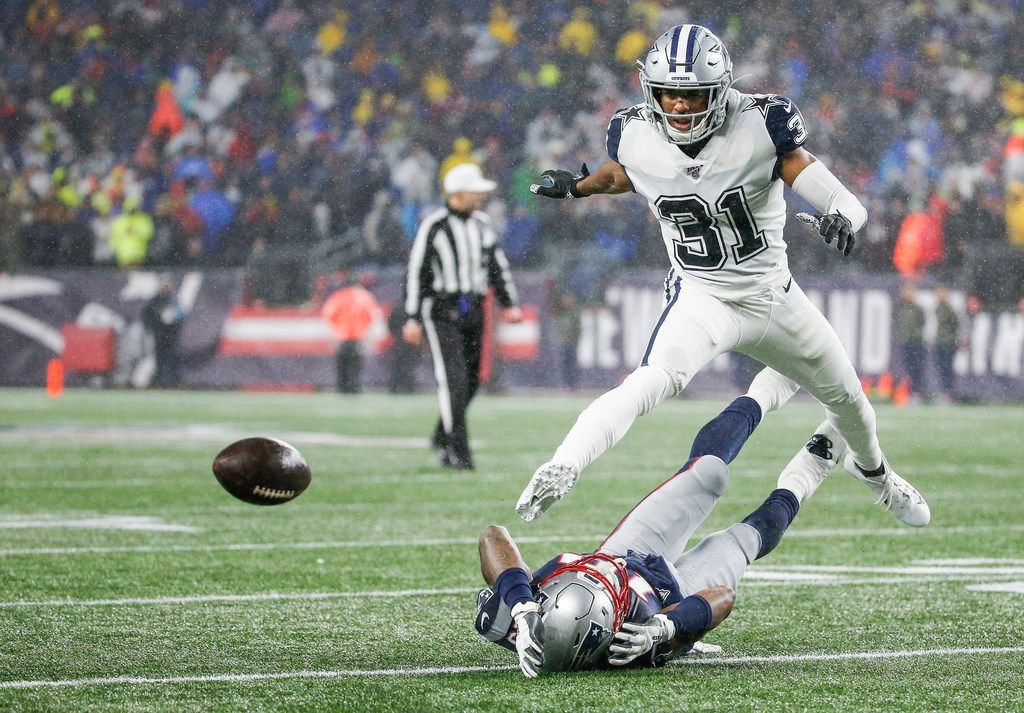 Dallas Cowboys cornerback Byron Jones (31) breaks up a pass intended for New England Patriots wide receiver N'Keal Harry (15) during the first half of an NFL matchup between the New England Patriots and the Dallas Cowboys at Gillette Stadium in Foxborough, Massachusetts on Sunday, Nov. 24, 2019.