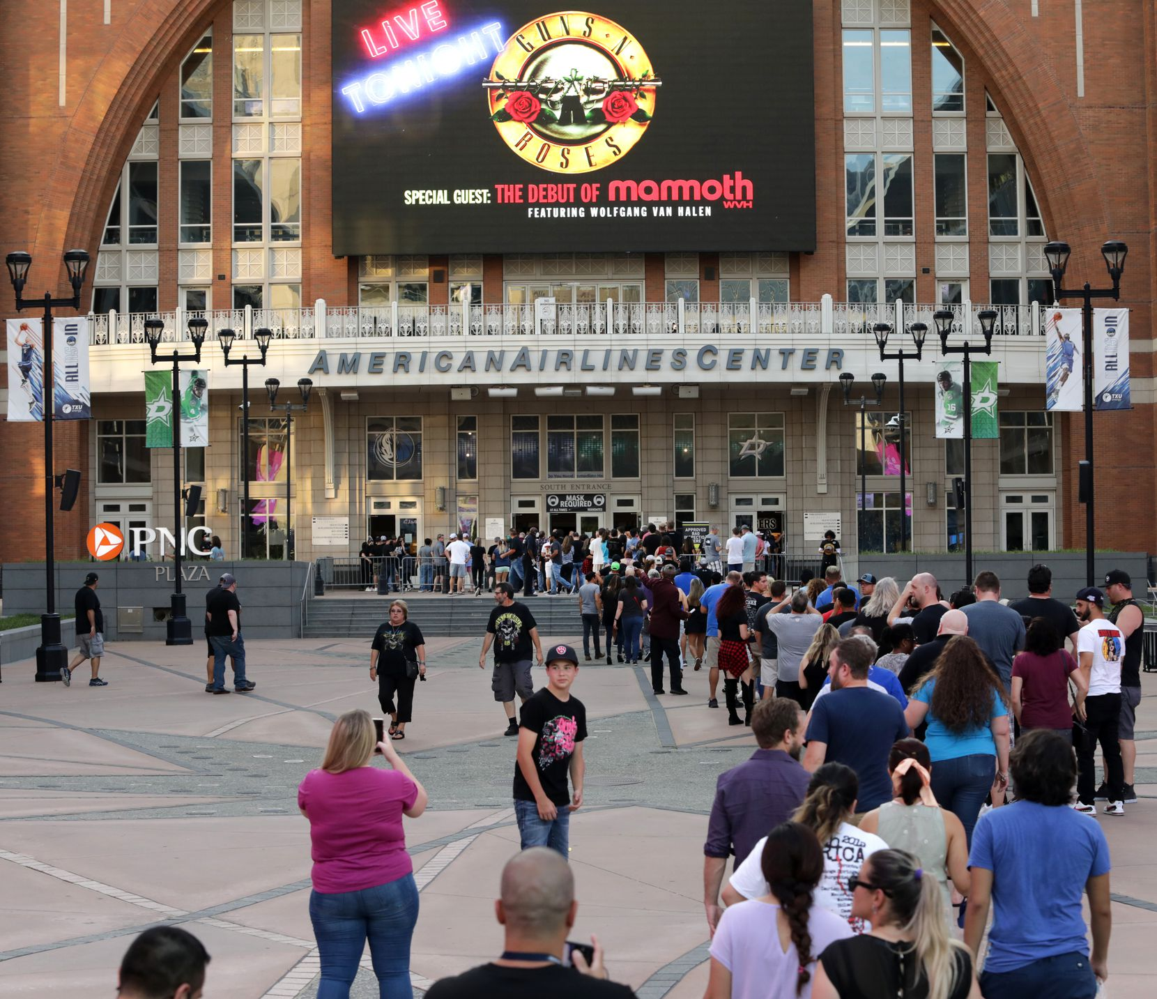 Fans make their way into the center Wednesday night, where masks were required.
