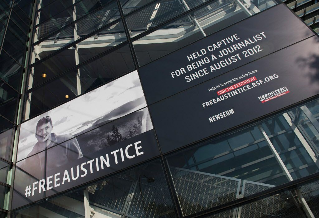 A banner calling for the release of Austin Tice, the only American journalist held captive in Syria, is displayed at the Newseum in Washington, DC on November 2, 2016.