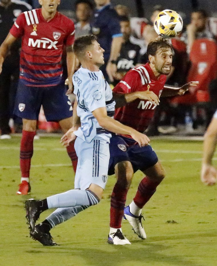 FC Dallas midfielder Facundo Quignon (5) gets a header in front of Sporting Kansas City midfielder Remi Walter (54) during the first half as FC Dallas hosted Sporting Kansas City at Toyota Stadium in Frisco on Wednesday, September 29, 2021. (Stewart F. House/Special Contributor)