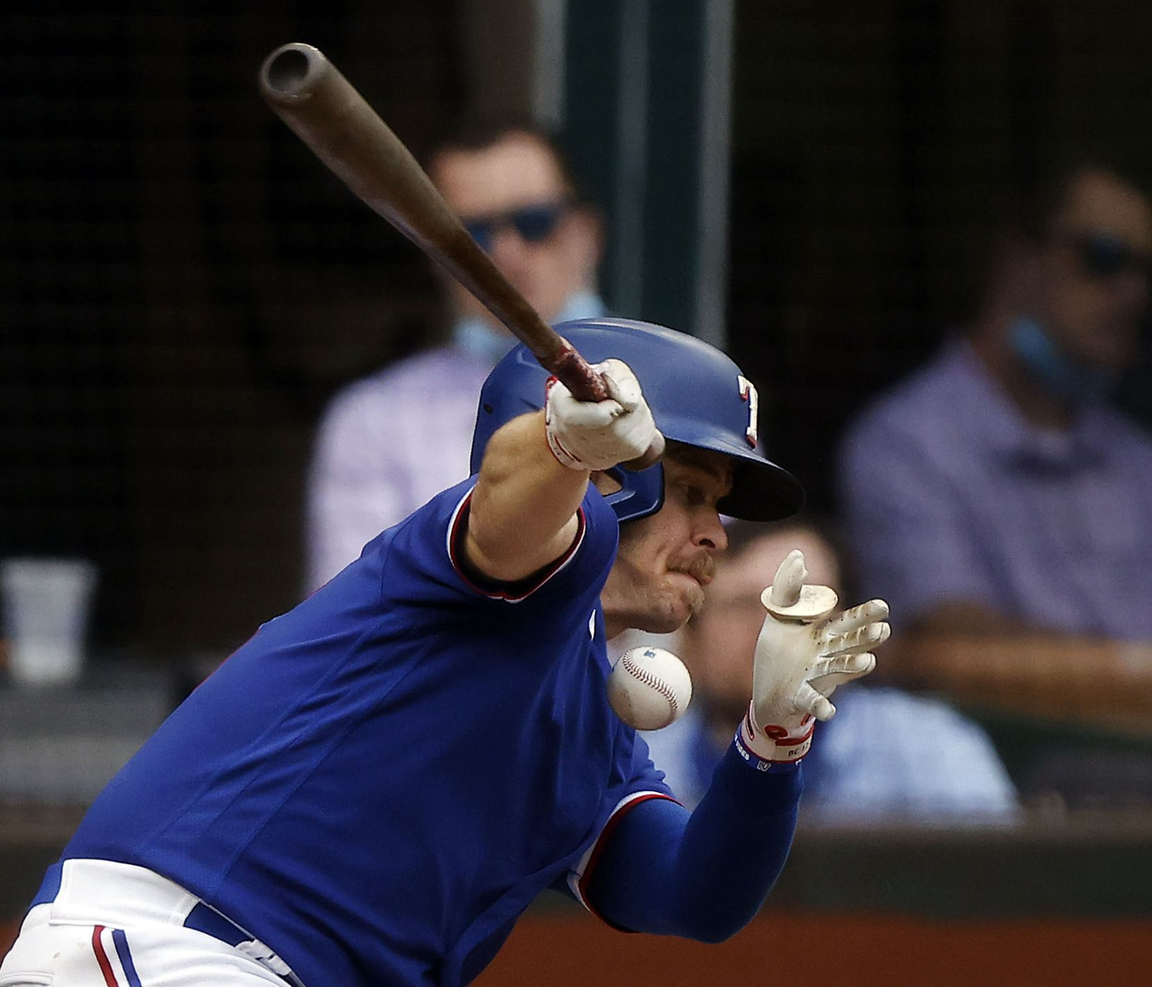 Texas Rangers batter Brock Holt (16) fouls a ball off his chest in the first inning against the Milwaukee Brewers at Globe Life Field in Arlington, Texas. The teams were playing in an exhibition game, Tuesday, March 30, 2021. (Tom Fox/The Dallas Morning News)