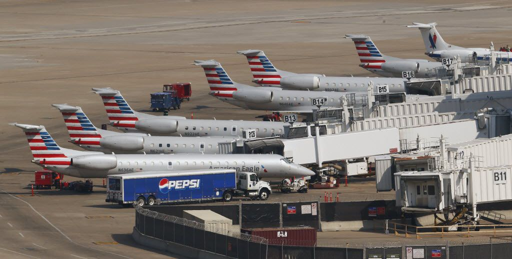 A line of American Eagle airplanes at Terminal B at DFW International Airport in Irving Friday,  July 31, 2015. (Nathan Hunsinger/The Dallas Morning News)