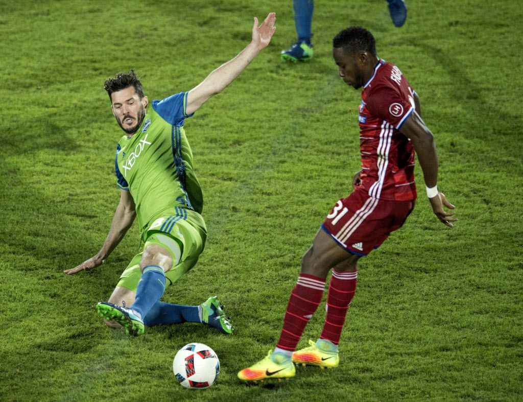 Seattle Sounders defender Brad Evans (3) slides in on FC Dallas defender Maynor Figueroa (31) during the second half of an MLS soccer western conference semifinal playoff match Sunday, Nov. 6, 2016 in Frisco, Texas. Though Dallas won 2-1, Seattle advanced to the western conference championship on aggregate score. (AP Photo/Jeffrey McWhorter)