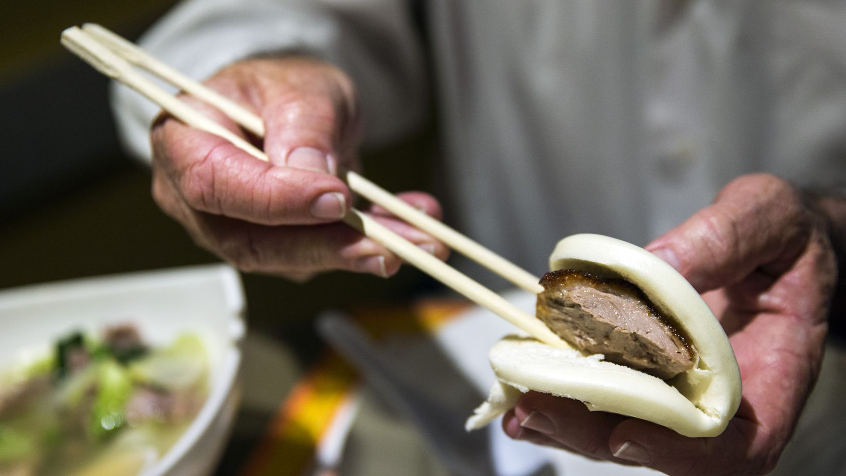 Peking duck is placed in a roll at First Chinese BBQ in Richardson. The Dallas suburb was lauded as one of the best foodie cities in the country.