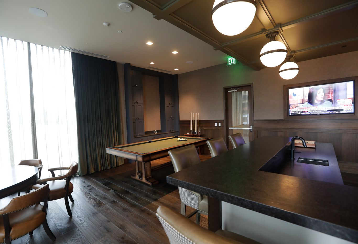 The gameroom and pub at Windrose Tower in Plano. (Jason Janik/Special Contributor)