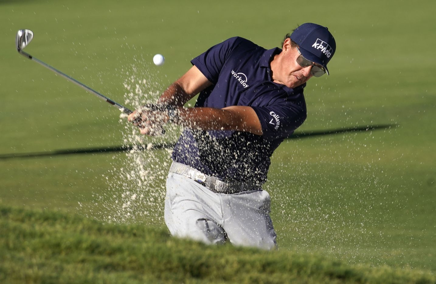 PGA golfers Phil Mickelson ties a shot out of the green side trap on No. 11 during the opening round of the Charles Schwab Challenge at the Colonial Country Club in Fort Worth, Thursday, June 11, 2020. The Challenge is the first tour event since the COVID-19 pandemic began. (Tom Fox/The Dallas Morning News)