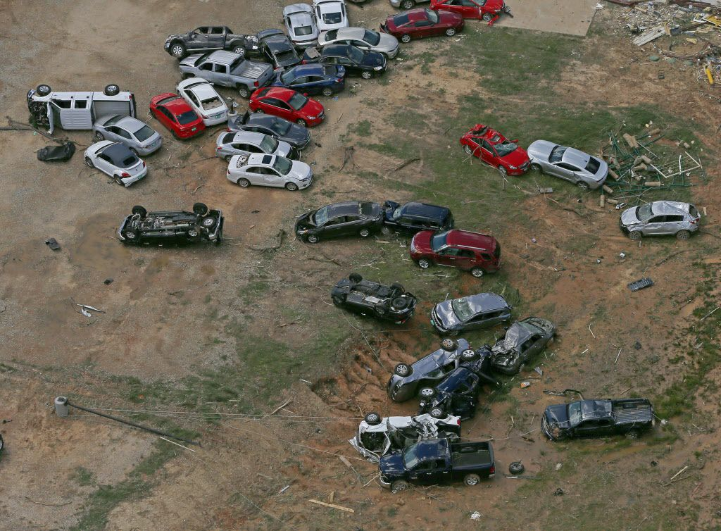 Damaged cars and trucks are washed off the parking lot of Interstate 20 Chrysler Dodge Jeep Ram of Canton in Canton, Texas, Sunday, April 30, 2017. Severe storms including tornadoes swept through several small towns killed at least four people in East Texas yesterday.