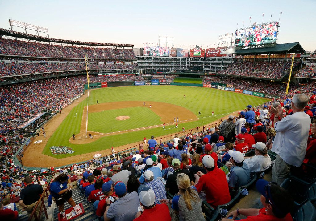 Texas Rangers fans cheer as the Texas Rangers finish an inning in a game against the Cleveland Indians on opening day at Globe Life Park in Arlington on Monday, April 3, 2017. (Vernon Bryant/The Dallas Morning News)