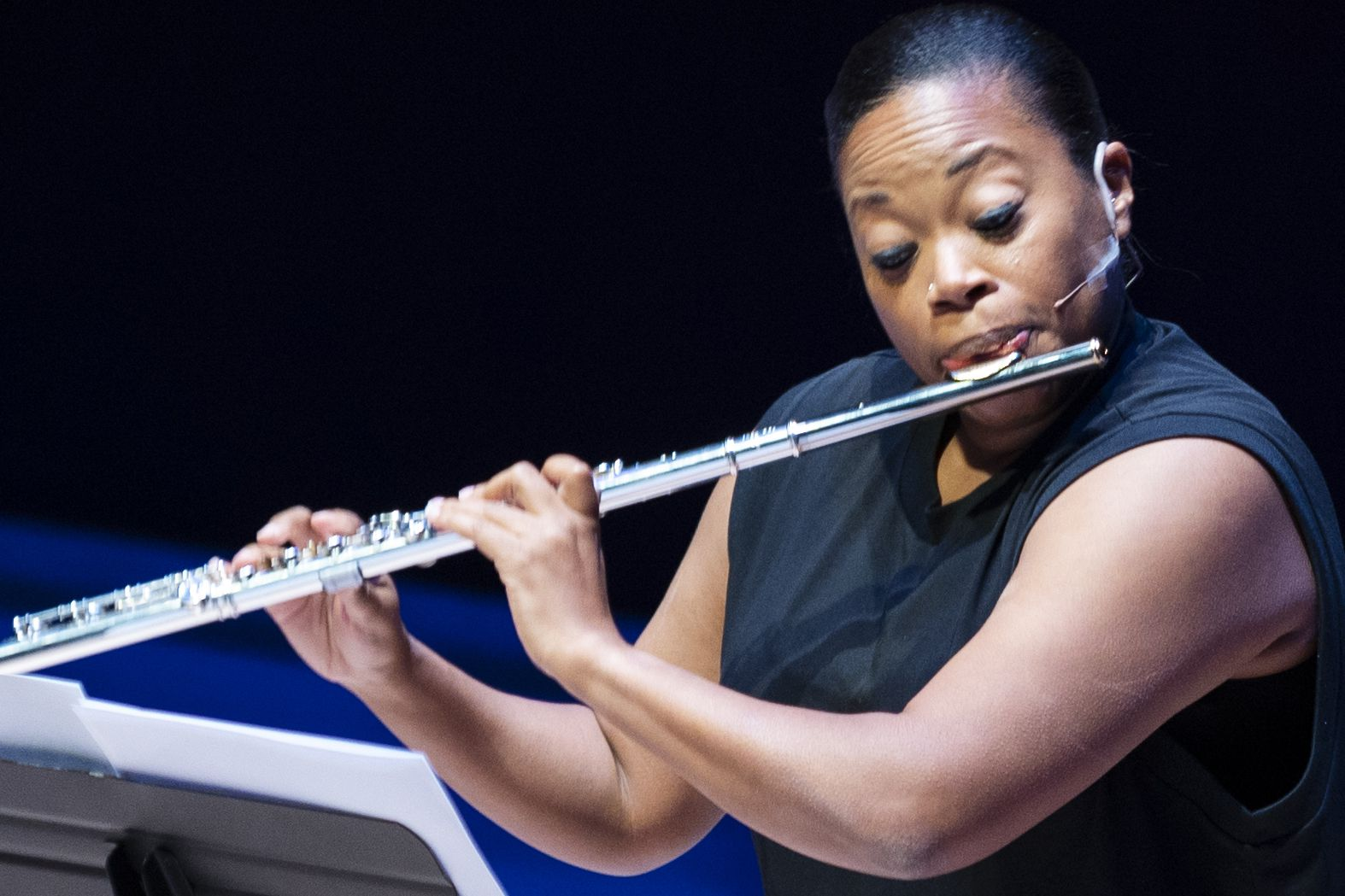 Flutist Ebonee Thomas performs 'NoaNoa' (1992) by Finnish composer Kaija Saariaho as part of the Voices of Change season opener on Sept. 19 at SMU's Caruth Auditorium in Dallas.