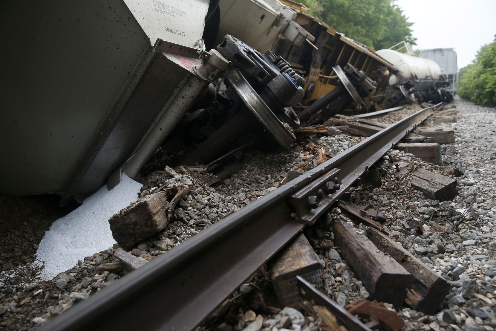 A white substance spilled from one of the cars lying tilted off the tracks Wednesday morning after a train derailment Monday night on the railroad line leading through the Tenison Park Golf Course near the 3600 block of Samuell Boulevard on the east side of Dallas.