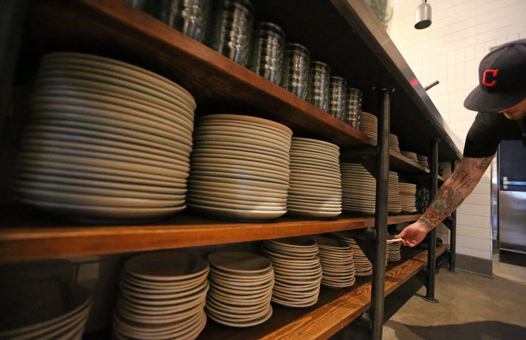 Dishes await use on a shelf at the new restaurant, Filament, at 2626 Main Street in Deep Ellum in Dallas, photographed on Tuesday, December 1, 2015. (Louis DeLuca/The Dallas Morning News)