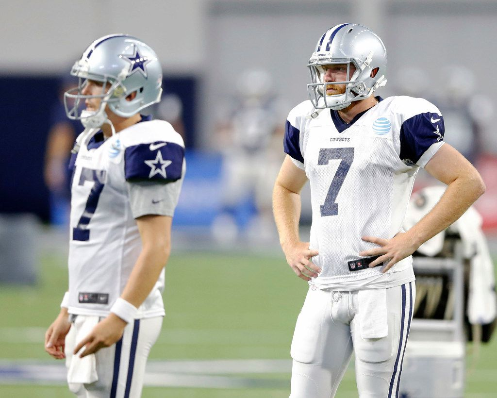 Dallas Cowboys quarterback Cooper Rush (7) and Dallas Cowboys quarterback Kellen Moore (17) watch as the first team goes through a play at practice during training camp at The Star in Frisco on Tuesday, August 22, 2017. (Vernon Bryant/The Dallas Morning News)