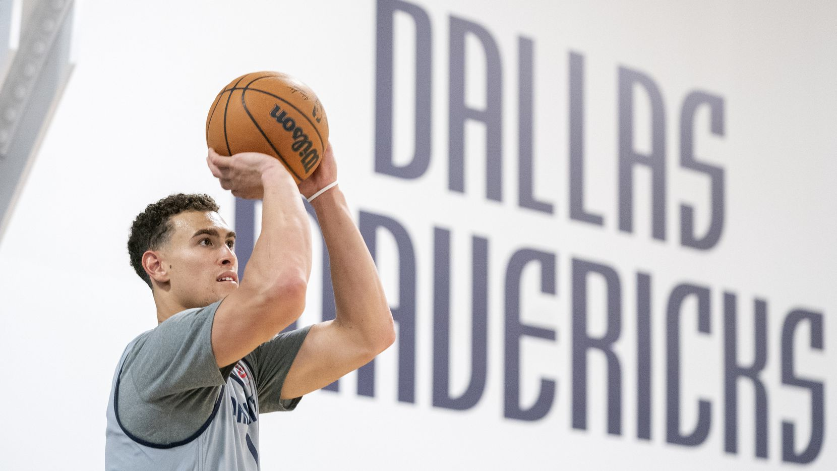 Dallas Mavericks center Dwight Powell (7) shoots a 3-pointer during the first practice of training camp, Tuesday, September 28, 2021 at the Dallas Mavericks Training Center in Dallas.