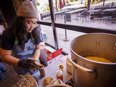 Chef Sarah Ranola preps sauces at a pop-up location of Hella Lumpia.