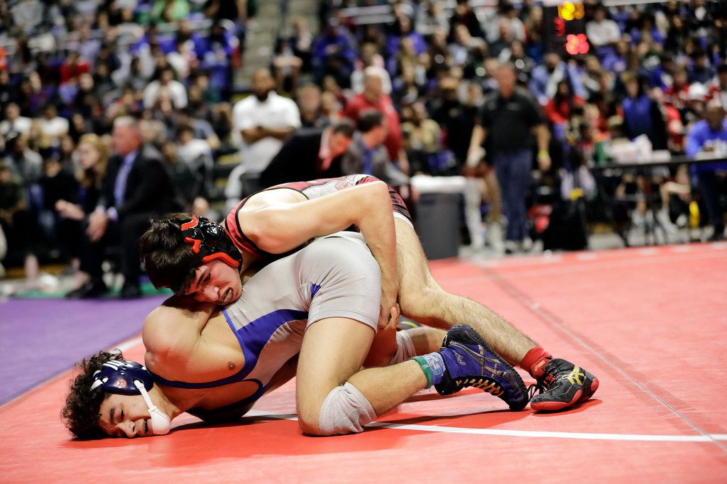 Dominic Chavez of Arlington Martin wrestles during the UIL Texas State Wrestling Championships, Saturday, February 22nd, 2020, at the Berry Center in Cypress, Texas. Chavez won the match.  Todd Spoth/Special Contributor ORG XMIT: hswrestlinglede_0223spo