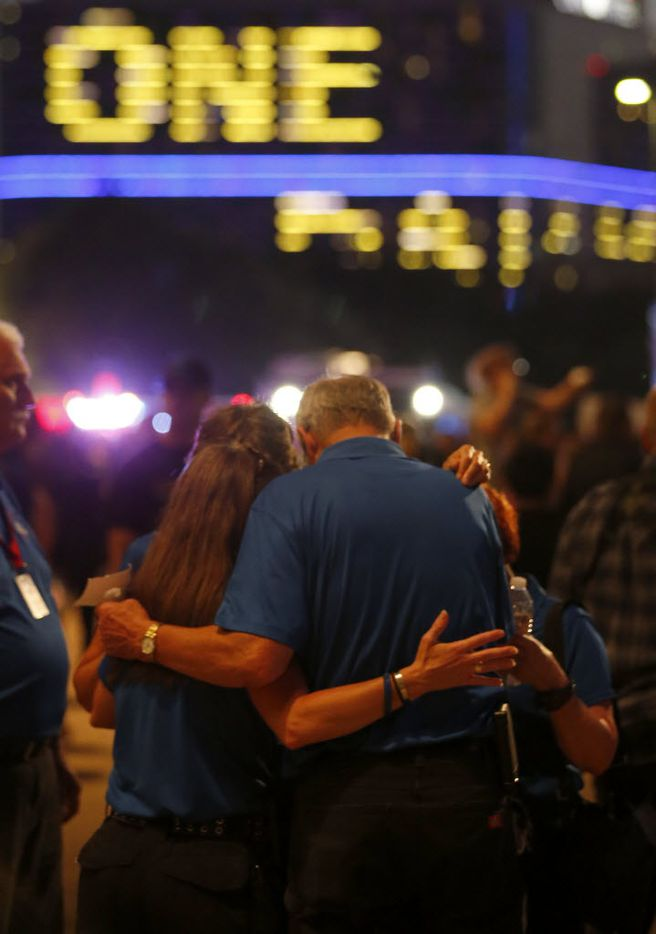 A group of the Billy Graham Rapid Response Team members prays after a candlelight vigil hosted by the Dallas Police Association in honor of the five police officers killed by the ambush attack in the line of duty at Dallas City Hall in downtown Dallas, Monday, July 11, 2016. (Jae S. Lee/The Dallas Morning News)