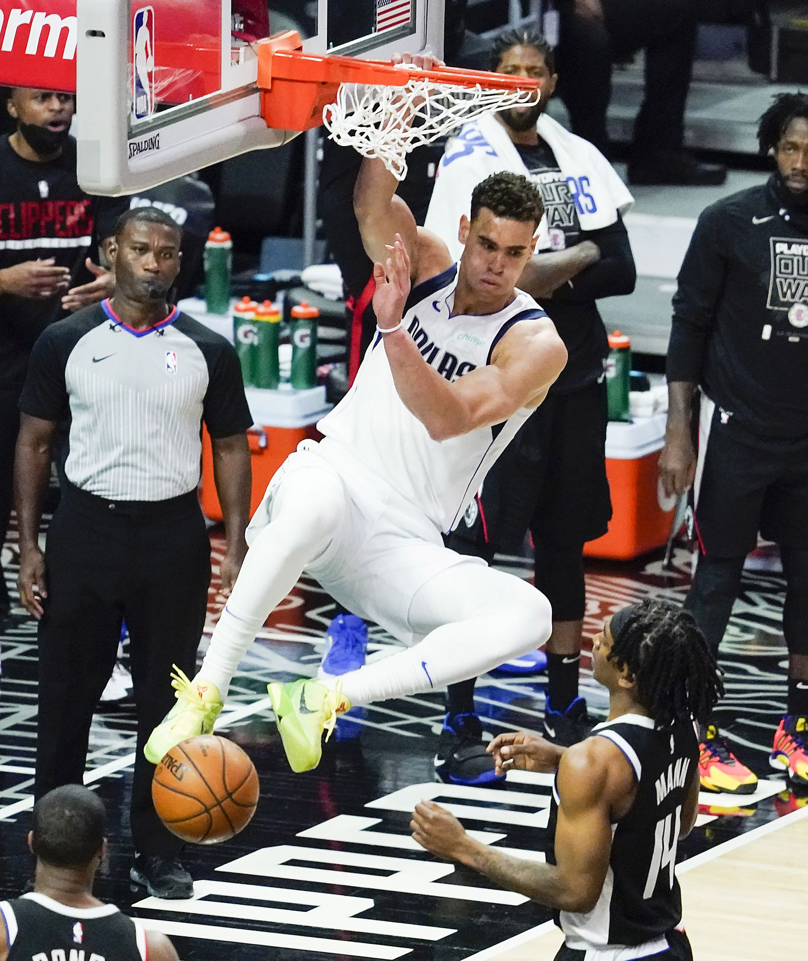 Dallas Mavericks center Dwight Powell (7) dunks the ball past LA Clippers guard Terance Mann (14) during the third quarter of an NBA playoff basketball game at the Staples Center on Wednesday, June 2, 2021, in Los Angeles.  (Smiley N. Pool/The Dallas Morning News)