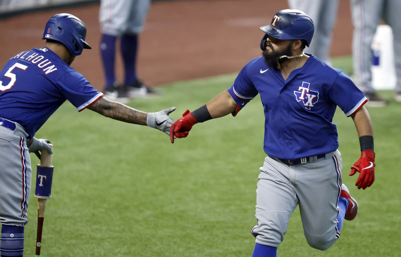 Texas Rangers Rougned Odor (right) is congratulated by teammate Willie Calhoun following his home run during a simulated Summer Camp game at Globe Life Field in Arlington, Texas, Thursday, July 9, 2020. (Tom Fox/The Dallas Morning News)