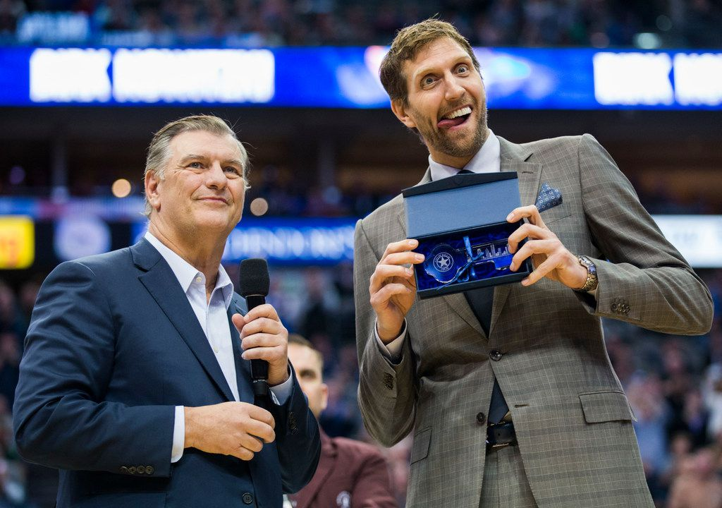Dallas Mavericks forward Dirk Nowitzki (41) makes a face as he poses with the key to the city of Dallas that was presented by Mayor Mike Rawlings during halftime of an NBA game between the Dallas Mavericks and the Brooklyn Nets on Wednesday, November 21, 2018 at the American Airlines Center in Dallas. (Ashley Landis/The Dallas Morning News)