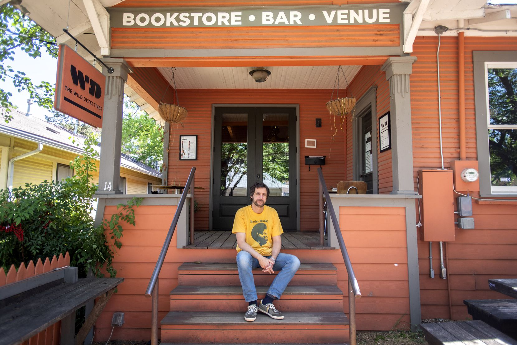 Javier Garcia del Moral, owner of The Wild Detectives bookstore and bar, poses for a portrait outside his quiet shop, Wednesday, April 29, 2020 in the Bishop Arts District in Dallas.