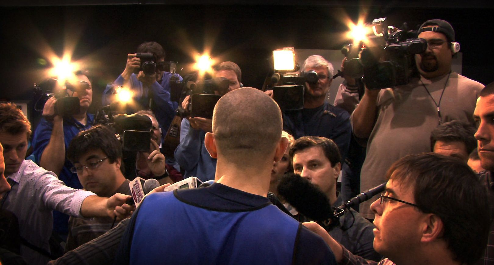 Dallas Mavericks point guard Jason Kidd is the center of the media's attention following his first practice with the team at the American Airlines Center, Tuesday, February 19, 2008.