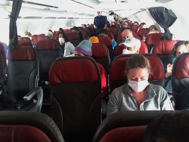 In this photo provided by a passenger who requested to be anonymous, passengers get ready before the doors close on a flight departing from Cusco, Peru, on March 25, 2020. Many Americans have been stranded since Peru drastically curtailed air travel during the COVID-19 pandemic.
